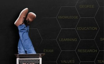 Image for Feedback Loop article - legs stretched out, laptop